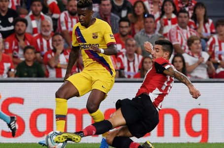 Soccer Football – La Liga Santander – Athletic Bilbao v FC Barcelona – San Mames, Bilbao, Spain – August 16, 2019 Barcelona's Nelson Semedo in action with Athletic Bilbao's Yuri Berchiche REUTERS/Vincent West