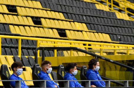 DORTMUND, GERMANY – MAY 16: FC Schalke 04 substitute players sit on the bench during the Bundesliga match between Borussia Dortmund and FC Schalke 04 at Signal Iduna Park on May 16, 2020 in Dortmund, Germany. The Bundesliga and Second Bundesliga is the first professional league to resume the season after the nationwide lockdown due to the ongoing Coronavirus (COVID-19) pandemic. All matches until the end of the season will be played behind closed doors. (Photo by Martin Meissner/Pool via Getty Images)