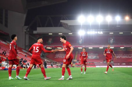 LIVERPOOL, ENGLAND – JULY 22: Alex Oxlade-Chamberlain of Liverpool celebrates after scoring his team's fifth goal with team mate Curtis Jones during the Premier League match between Liverpool FC and Chelsea FC at Anfield on July 22, 2020 in Liverpool, England. Football Stadiums around Europe remain empty due to the Coronavirus Pandemic as Government social distancing laws prohibit fans inside venues resulting in all fixtures being played behind closed doors. (Photo by Laurence Griffiths/Getty Images)