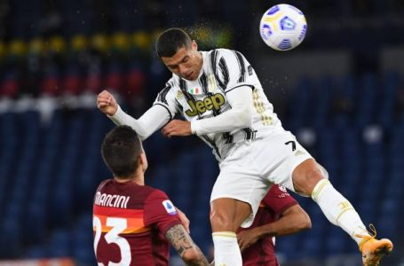 ROME, ITALY – SEPTEMBER 27: Cristiano Ronaldo of Juventus heads the ball and score goal 2-2 during the Serie A match between AS Roma and Juventus at Stadio Olimpico on September 27, 2020 in Rome, Italy. (Photo by Silvia Lore/Getty Images)
